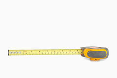 Yellow measuring tape partly unrolled Stock Photo