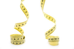 Yellow measuring tape rolled Stock Photography