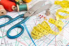 Yellow measuring tape and sewing items. Yellow measuring tape and vintage sewing items Royalty Free Stock Image