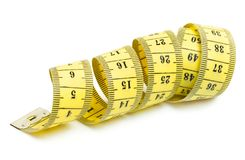 Yellow measuring tape spiral on white. Measuring tape isolated on white background Royalty Free Stock Image