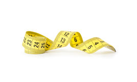 Yellow measuring tape for tailor. On white Stock Photo