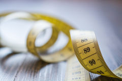 Yellow Measuring Tape of the Tailor. Royalty Free Stock Photo