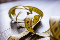 Yellow measuring tape of the tailor. Stock Images