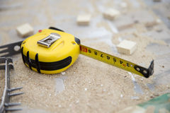 Yellow measuring tape on the workplace Royalty Free Stock Image