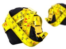 Yellow measuring tapes. Isolated on a white background Stock Image