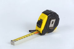 Yellow Measuring tool. Yellow Roulette Measure Building Tool oppened for 10 centimeters Royalty Free Stock Photo