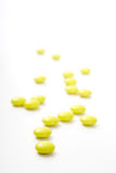 Yellow medical tablets, over white stock images