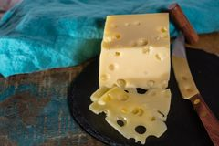 Yellow medium-hard mild Swiss cheese Emmental Stock Image