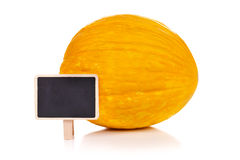 Yellow melon with blackboard Royalty Free Stock Image