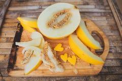 Yellow melon Cantaloupe  slices with shape heart Stock Photo
