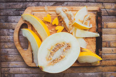 Yellow melon Cantaloupe  slices with shape heart Royalty Free Stock Image
