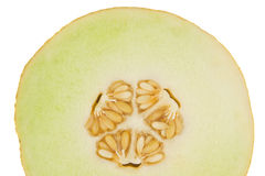 Yellow melon cut in half and isolated in white Royalty Free Stock Photo