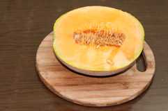 Yellow melon cut in half and served Stock Photo