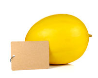 Yellow melon full ball with Brown paper label on white backgroun Royalty Free Stock Images