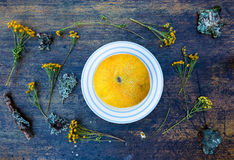 Yellow melon half and wildflowers Royalty Free Stock Photos