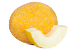 Yellow melon with slices Royalty Free Stock Photos