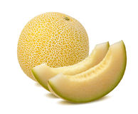 Yellow melon, whole and pieces, isolated on white stock photography