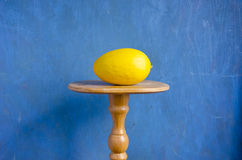 Yellow melon on wooden table Royalty Free Stock Photos