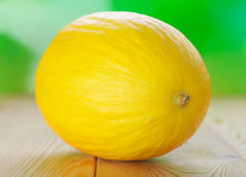 Yellow melons on wooden table Stock Photos