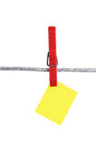 Yellow memo on clothesline Stock Photography