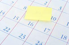 Yellow memo note on a calendar Stock Image