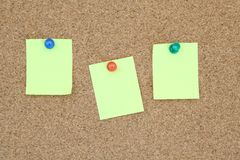 Yellow memo on notice board Royalty Free Stock Photo