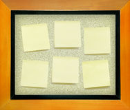 Yellow memo  paper on cork board Royalty Free Stock Photos