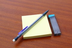 Yellow memo post and mechanical pencil Royalty Free Stock Photography