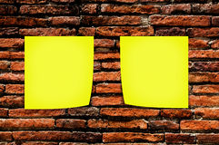 Yellow memo stick on brick wall background Royalty Free Stock Photo