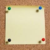 Yellow memo stick on cork board background Stock Photo