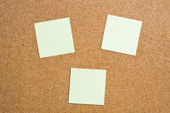 Yellow memo stick on cork board background Royalty Free Stock Images