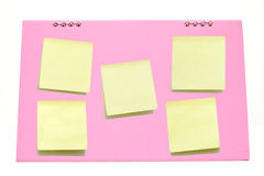 Yellow memo stick on Pink calendar Royalty Free Stock Image