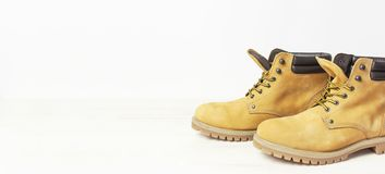 Free Yellow Men`s Work Boots From Natural Nubuck Leather On Wooden White Background. Trendy Casual Shoes, Youth Style. Concept Of Stock Images - 134710834