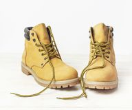 Free Yellow Men`s Work Boots From Natural Nubuck Leather On Wooden White Background. Trendy Casual Shoes, Youth Style. Concept Of Stock Photography - 134710882