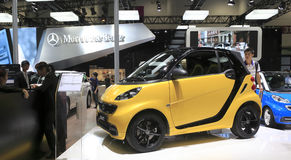 Yellow mercedes-benz smart   car Royalty Free Stock Image