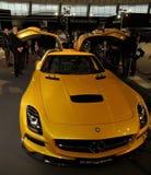 Yellow seagul car AMG Mercedes SLS AMG Black serie. Yellow Mercedes, yellow car in a showroom. Powerful German coupe. Yellow seagul car AMG Mercedes SLS AMG royalty free stock images