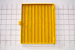 Yellow mesh shutter on white wall Stock Images