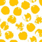 Yellow Messy Grunge Polka Dot. Grungy dotted seamless pattern. Messy grunge polka dot. Grungy dotted seamless pattern. Brush strokes, paint splashes. Textured Stock Photo
