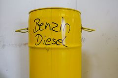 A yellow metal barrel with the inscription petrol and diesel stock photography