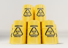 Yellow metal barrels with black biohazard warning sign  on white background Royalty Free Stock Photos
