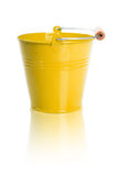 The yellow metal bucket  on a white background Royalty Free Stock Photos