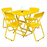 Yellow metal cafe table and chairs outdoors on white.with clipping part. Royalty Free Stock Photo