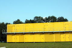 Yellow metal containers Stock Image