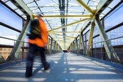 Yellow metal corridor, crowd mooving Royalty Free Stock Image