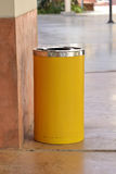 Yellow metal cylinder bin Stock Image
