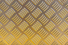 Yellow metal diamond plate pattern background. Royalty Free Stock Photography