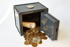Yellow metal dollars and bills different currencies in gray safe, isolated royalty free stock images