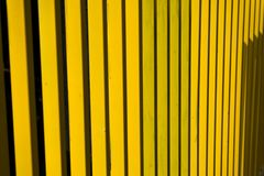 Yellow metal fence abstract stripes Stock Photo