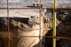 Yellow metal fence on asphalt repair. Is close stock photos