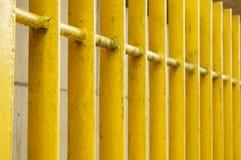 Yellow metal fence Stock Photography
